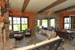 Lighthouse Pointe was built using natural local stone, reclaimed timber beams and heart pine flooring, Pennsylvania bluestone and custom built fireplaces with hand crafted brick.