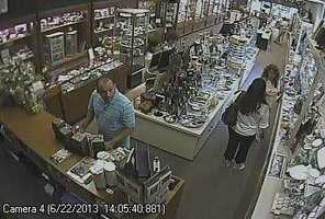 Police said the first group of people kept the employees distracted while the second couple opened a jewelry case