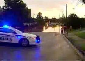 Heavy rains caused flash street flooding on Pearl Street in Spartanburg.