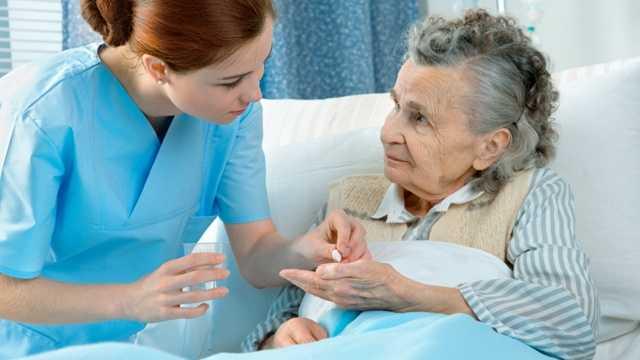 Nurse with senior woman, nursing home
