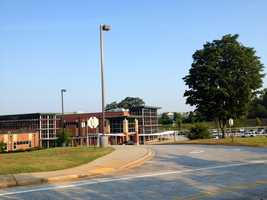The teacher was mugged as she got out of her car Monday morning, according to police and school officials.