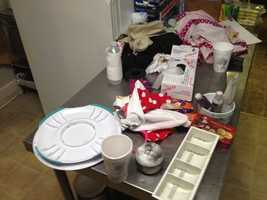 He moved items, covering tables/work spaces that had been clean.