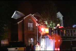 Fire officials say a woman saw the fire in her apartment, but her alarm didn't go off.