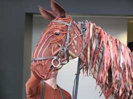 A puppeteer at the head controls the ears and head&#x3B; one in the heart controls breathing and front legs&#x3B; a third in the hind controls the tail and back legs.