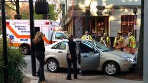 Car into tree disrupts downtown traffic