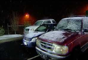 A light snow started falling before 6 a.m. on Wednesday, collecting on cars, bushes and grassy areas.