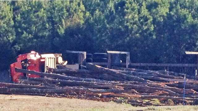 logging truck overturns