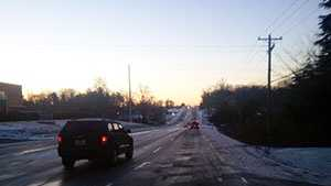 icy road with cars