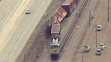 Authorities say three boxcars carrying paper derailed off a train track near Prosperity.