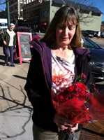 Aliska Tamera brought flowers to the cafe in Laurey Masterton's memory.