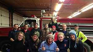 Madison Kinast, 23, Bekah Alva, 23, Haley York, 19, Brianna Bell, 19 and Mary Kate Schopp, 19, with rescuers from the Spring Creek Fire Department.