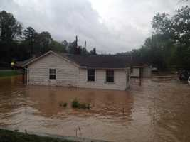 A creek overflowed its banks in Western North Carolina forcing an emergency water rescue, according to Buncombe County Emergency Management. Click through to see more pictures.