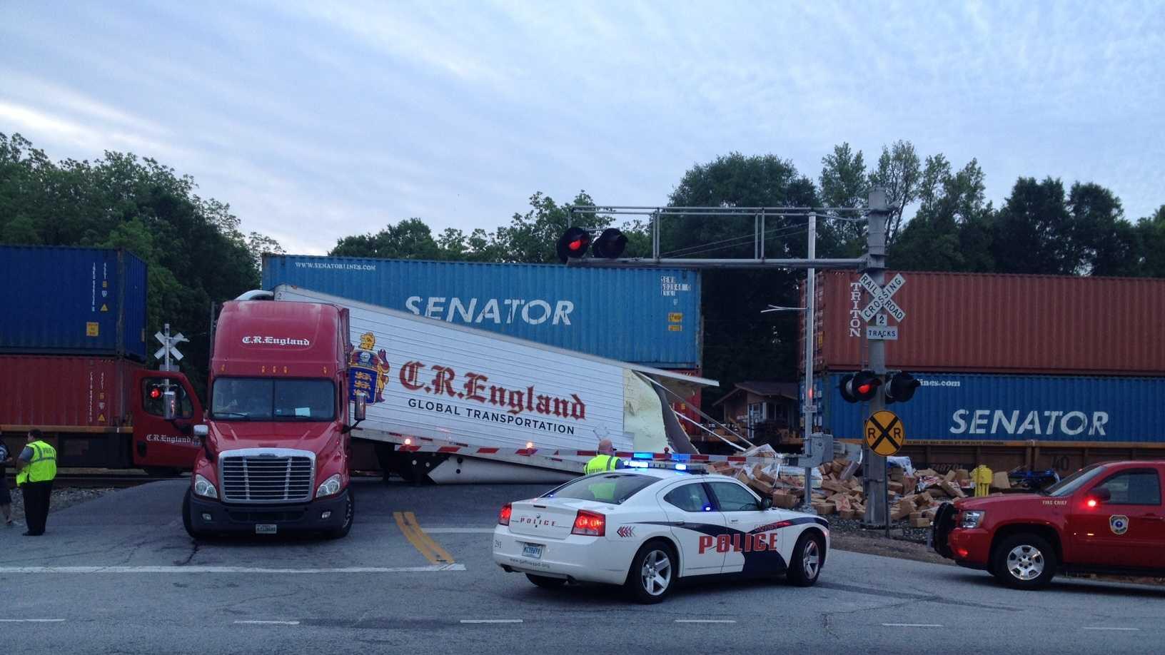 train tractor trailer collide