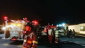 img - Crews on scene of bowling alley fire