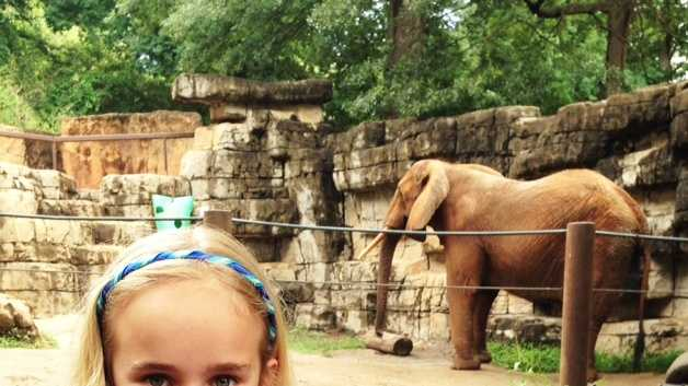 8-year-old Rylie Shaw poses for one last picture with Joy at the Greenville Zoo.