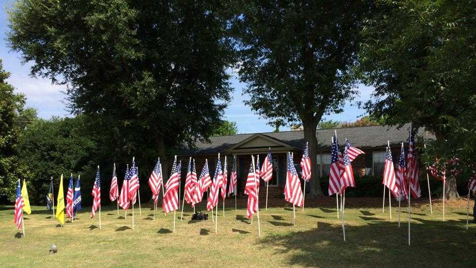 60 Flags in front lawn