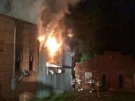 Flames poured out of the side of Blue Ridge Antiques and Refinishing in Pendleton early Tuesday.