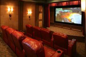 """The home features a home theater with 110"""" screen, sauna, hot tub, full wet bar with built in keg, 2000 bottle wine cellar, saltwater aquarium and fully equipped workout room."""