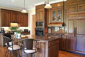 The lower level has a gourmet chef's kitchen, a large recreation room that features a wood burning fireplace, built-in cabinets, and a beverage center.