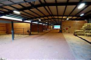 It also has 2 barns and horse equipment.