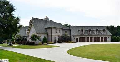 Inman: This Inman home has a gated entrance with an intercom and code system that leads to the 29 acre estate.