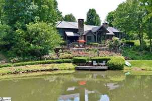Landrum: This home is an equestrian estate property nestled in the foothills of the Blue Wall of the Blue Ridge Mountains. It features 2 creeks and a 5.5 acre lake.