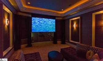 """The state of the art media room includes full Dolby surround sound, a high definition Sony video projector, a 108"""" retractable video screen, and two closets to house the equipment. There is also a fully integrated gaming and theater system which is available for purchase. This home is listed on realtor.com for $1,520,000."""