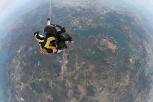 Mandy went skydiving from 13,000 feet with the 101st Airborne Division.