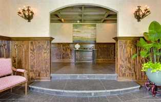 The foyer has a coffered ceiling and Jamestown Bluestone with fossilized detail.