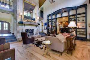 The great room has floor-to-cathedral ceiling Indiana sandstone fireplace and hearth.