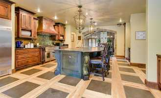The flooring is a unique basket weave of wide plank hickory with an inlay of Jamestown Bluestone.