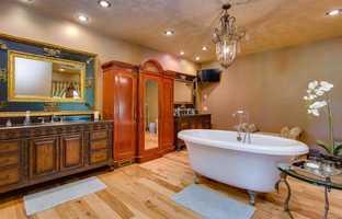 The home has three full baths and two half baths.
