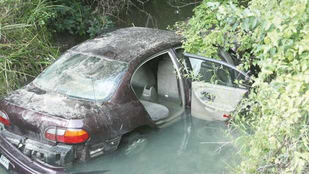 Woman trapped in car