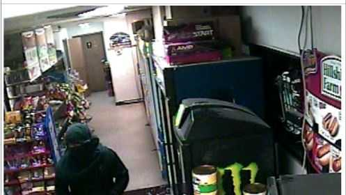 Police search for convenience store robbery suspect with a strut