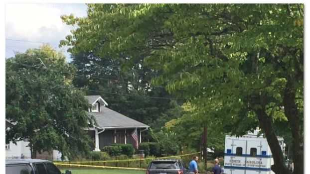 Investigators remain at the scene of shooting that injured a deputy and left one person dead.