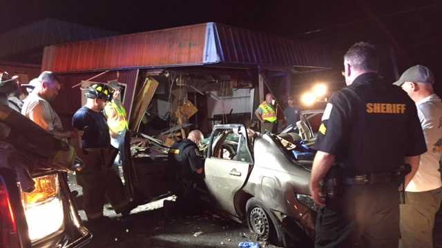 Car crashes into building after police chase, dispatchers say