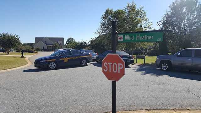 Sheriff's deputy cars block the area on Links and Wild Heather Drives.