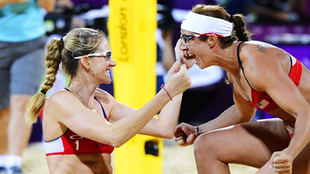 Kerri Walsh, left, celebrates with Misty May during their gold medal match in London. (Aug. 2012)