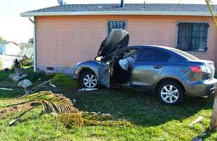 On Nov. 26, a driver in Salinas crashed into a pink house with black bars over the windows while attempting to flee from Monterey County Sheriff's deputies.After careening into the one-story house, three people who were inside the car jumped out and escaped by running into Natividad Creek Park.Deputies said they were attempting to pull the driver over because he was on probation. The car plowed through a white picket fence and crashed next to the pink house's front door on Nogal Drive near Amarillo Way.