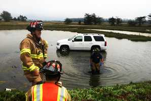 A young woman driving a sport utility vehicle veered off Highway 1 and splashed into Elkhorn Slough near Struve Road on July 9, 2013. North Monterey County firefighter Doug McCoun said the woman took her eyes off the road for a moment at 2 p.m. to reach for something, and her SUV went off the highway just north of Moss Landing.The woman escaped from her SUV with help from firefighters. She was embarrassed but not injured, firefighters said.
