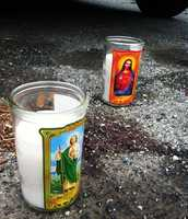 Blood and memorial candles are seen on Parkside Drive where Ruben Francisco, 23, was killed by two gunmen Aug. 4.