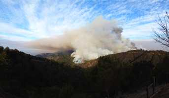 Smoke rises over Big Sur Monday.