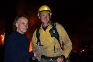 Al Jardine thanks U.S. Forest Service firefighter Andrew Kenner, 27, of Watsonville.