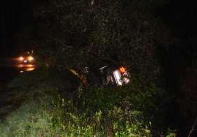 While roads were slick from rain, a driver lost control in Pebble Beach on March 30, 2014. The car landed in trees and the driver escaped without major injuries.