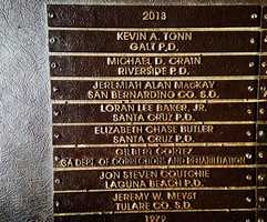 During an emotional ceremony, SCPD Det. Loran Butch Baker and Det. Elizabeth Butler were added to the state memorial wall during the California Peace Officers' Memorial Ceremony in Sacramento. (May 5, 2014)