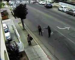 MAY 20, 2014:  Carlos Mejia is seen here seconds before the two officers opened fire and he died.