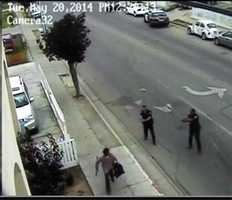 MAY 20, 2014:  Carlos Mejia is seen here 1 second before the two officers opened fire and he died.
