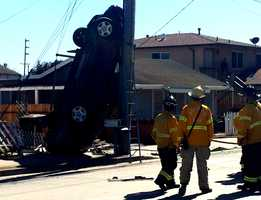 A car barreled through a Salinas neighborhood Monday and landed vertically against a power pole. The driver died inside the car after the 3 p.m. wreck.  (Sept. 15, 2014)