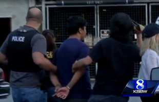 Gonzalez is led away in handcuffs from the Tannery Arts Center the evening he was arrested.