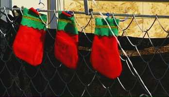 Someone hung three Christmas stockings for Shaun, Delylah, and their 9-year-old sister.